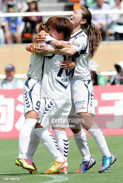 Nahomi Kawasumi celebrates the first goal from the spot with her teammates Shinobu Ohno and Homare Sawa during the Nadeshiko League match between NTV...
