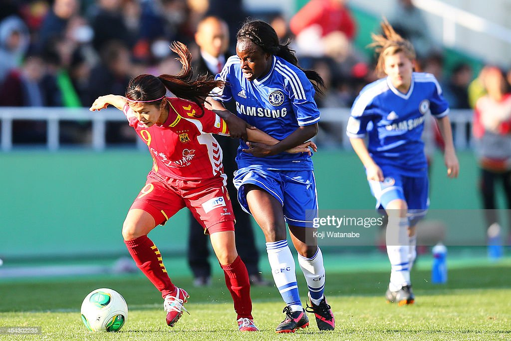 Nahomi Kawasumi of INAC Kobe Leonessa and Eniola Aluko of Chelsea Ladies compete for the ball during the International Women's Club Championship final match between Chelsea Ladies and INAC Kobe Leonessa at Ajinomoto Field Nishigaoka on December 8, 2013 in Tokyo, Japan.