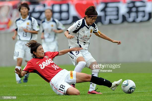 Nahomi Kawasumi of INAC Kobe Leonessa and Miyuki Yanagita of Urawa Red Diamonds Ladies compete for the ball during the Nadeshiko League match between...