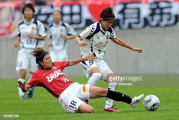 Nahomi Kawasumi of INAC Kobe Leonessa and Miyuki Yanagita of Urawa Red Diamonds Ladies compete for the ball during the Nadeshiko League match between...