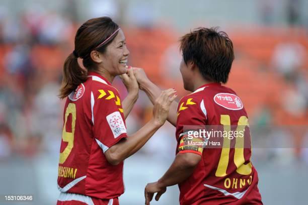 Nahomi Kawasumi of INAC Kobe Leonessa celebrates Shinobu Ohno's goal during the Nadeshiko League match between AS Elfen Sayama and INAC Kobe Leonessa...