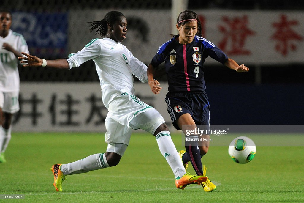 Nahomi Kawasumi #9 of Japan (R) and Azizat Oshoala #9 of Nigeria compete for the ball during the Women's international friendly match between Japan and Nigeria at Fukuda Denshi Arena on September 26, 2013 in Chiba, Japan.