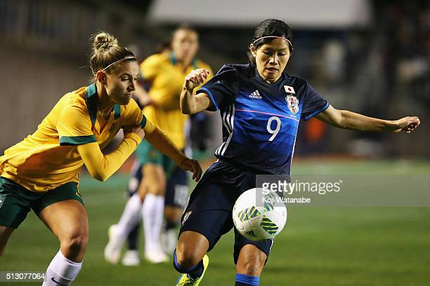 Nahomi Kawasumi of Japan and Chloe Logarzo of Australia compete for the ball during the AFC Women's Olympic Final Qualification Round match between...