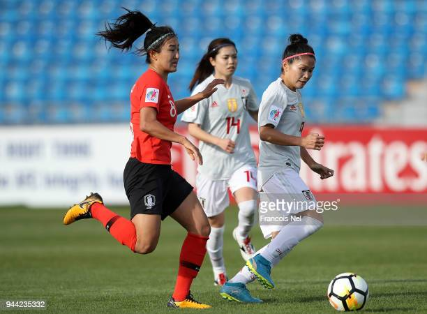 Nahomi Kawasumi of Japan and Cho So Hyun of Korea chase the ball during the AFC Women's Asian Cup Group B match between South Korea and Japan at the...