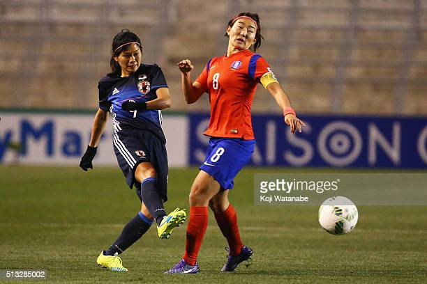 Nahomi Kawasumi of Japan and Cho So Hyun of South Korea compete for the ball during the AFC Women's Olympic Final Qualification Round match between...