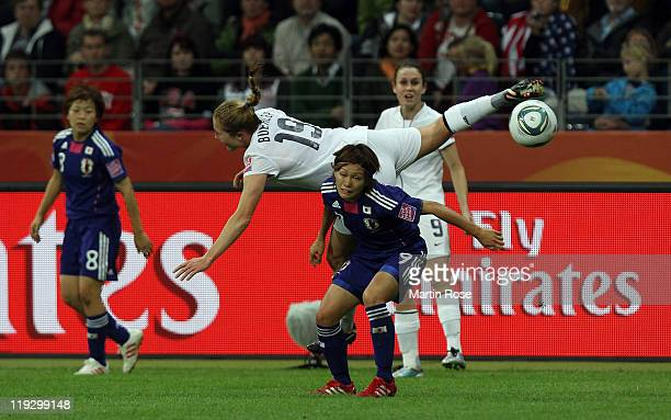 Nahomi Kawasumi of Japan and Rachel Buehler of USA battle for the ball during the FIFA Women's World Cup Final match between Japan and USA at the...