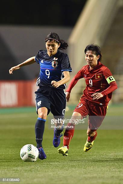 Nahomi Kawasumi of Japan and Tran Thi Thuy Trang of Vietnam compete for the ball during the AFC Women's Olympic Final Qualification Round match...
