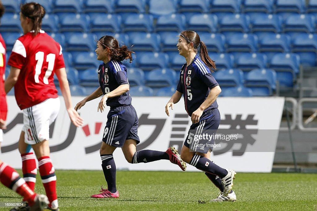 Nahomi Kawasumi of Japan celebrates her goal (0-1) followed by Aya Sameshima of Japan during the Algarve Cup 2013 match between Denmark and Japan at the Algarve stadium on March 11, 2013 in Faro, Portugal.