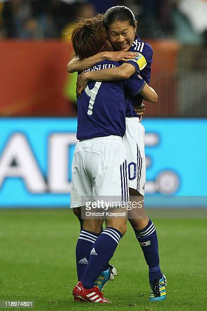 Nahomi Kawasumi of Japan celebrates the first goal with Homare Sawa of Japan during the FIFA Women's World Cup Semi Final match between Japan and...