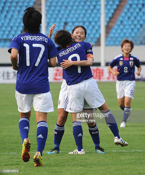Nahomi Kawasumi of Japan celebrates the first goal with Homare Sawa during the London Olympic Women's Football Asian Qualifier match between Japan...