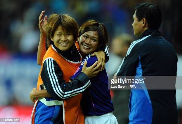 Nahomi Kawasumi of Japan celebrates with a team mate during the FIFA Women's World Cup Semi Final match between Japan and Sweden at the FIFA World...