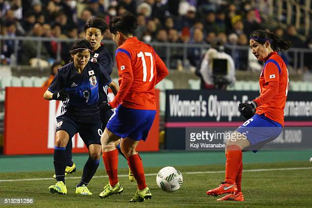 Nahomi Kawasumi of Japan competes for the ball against Kim Soo Yun and Hwang Boram of South Korea during the AFC Women's Olympic Final Qualification...