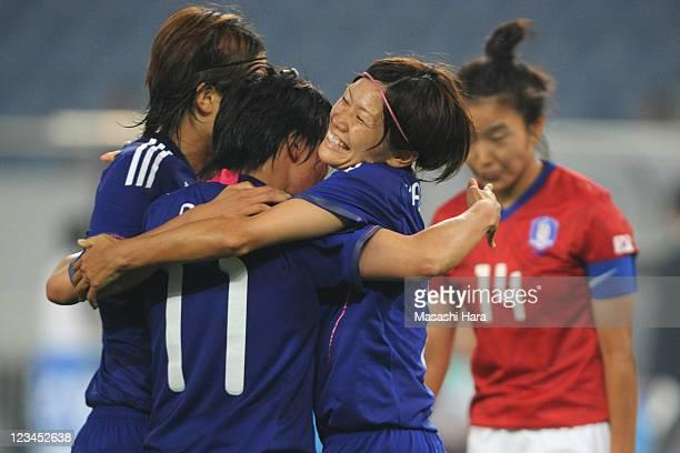 Nahomi Kawasumi of Japan congratulates Shinobu Ohno for her goal during the London 2012 Olympic Women's Football Asian Qualifier match between South...