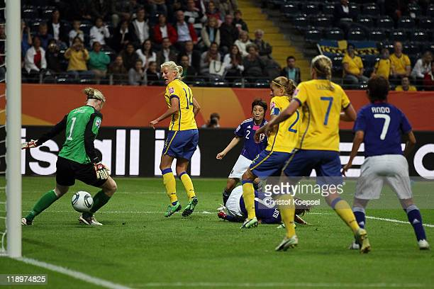 Nahomi Kawasumi of Japan scores the first goal and Hedvig Lindahl of Sweden lets the ball through her legs during the FIFA Women's World Cup Semi...