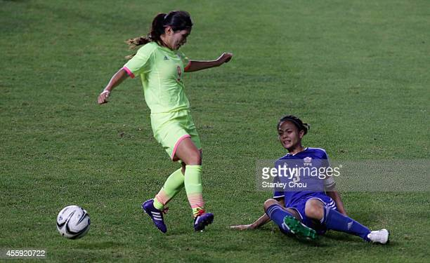Nahomi Kawasumi of Japan shields the ball away from Lin Man Ting of Chinese Taipei during the Football Womens Group B match between Chinese Taipei...