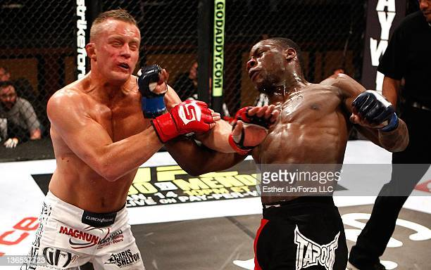 Nah-Shon Burrell punches James Terry during the Strikeforce event at the Hard Rock Hotel and Casino on January 7, 2012 in Las Vegas, Nevada.