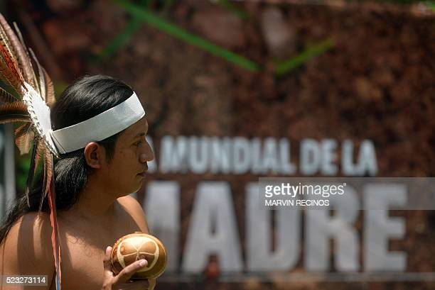 A Nahua Pipil indigenous man performs during the commemoration of the Earth Day in San Salvador on April 22 2016 Countries around the world annually...