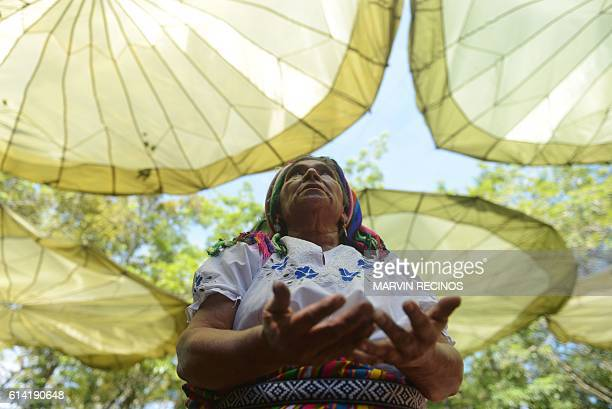 A Nahua Pipil indigenous woman participates in a ceremony commemorating the International Day of Indigenous Resistance at the San Andres...