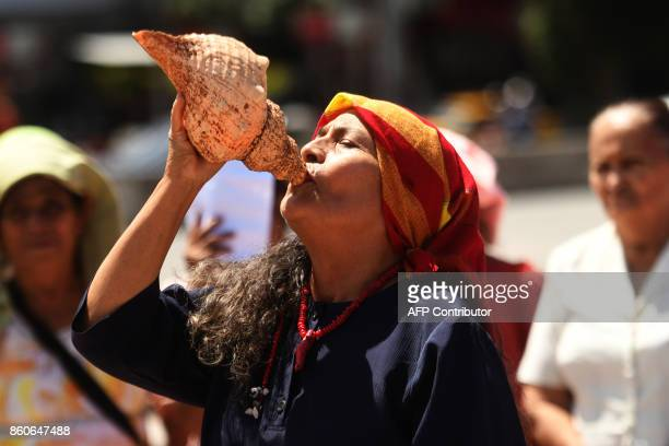 A Nahua Pipil indigenous woman participates in a ceremony commemorating the International Day of Indigenous Resistance at the Salvador del Mundo...