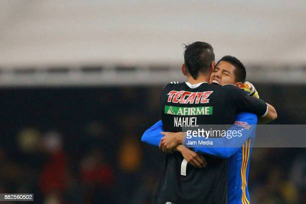Nahuel Guzman and Hugo Ayala of Tigres celebrate during the semifinal first leg match between America and Tigres UANL as part of the Torneo Apertura...