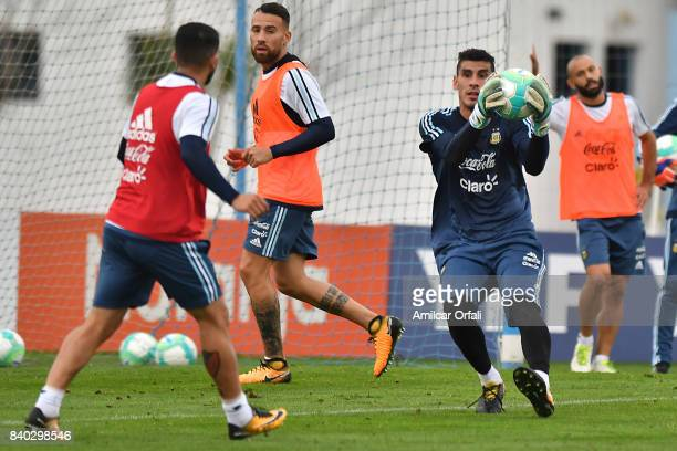 Nahuel Guzman goalkeeper of Argentina holds the ball during a training session at 'Julio Humberto Grondona' training camp on August 28 2017 in Ezeiza...