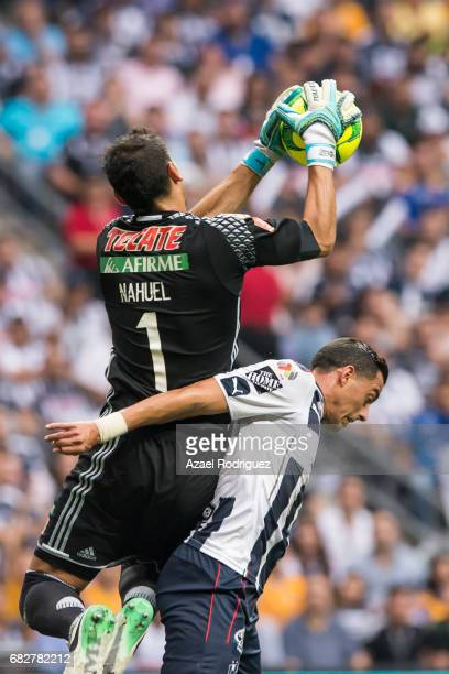 Nahuel Guzman goalkeeper of Tigres fights for the ball with Rogelio Funes Mori of Monterrey during the quarter finals second leg match between...