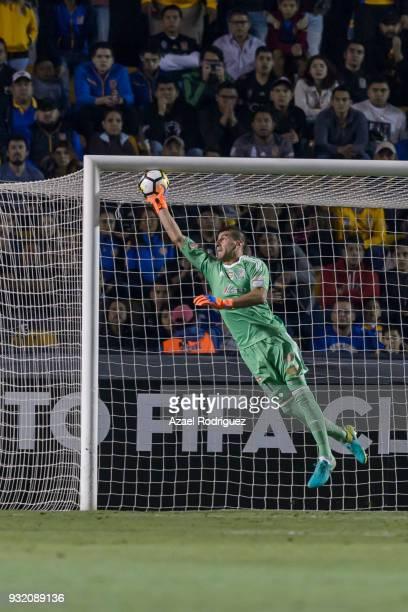 Nahuel Guzman goalkeeper of Tigres receives a goal scored by Sebastian Giovinco of Toronto during the quarterfinals second leg match between Tigres...