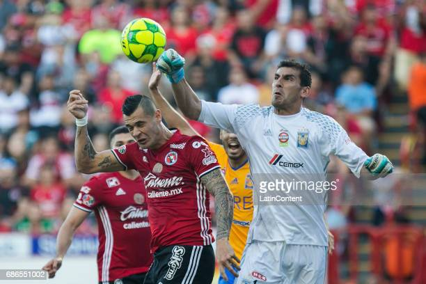 Nahuel Guzman goalkeeper of Tigres rejects the ball during the semi finals second leg match between Tijuana and Tigres UANL as part of the Torneo...