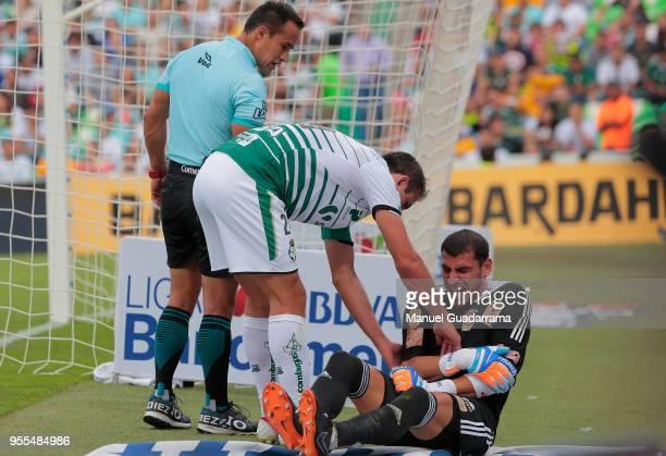 Nahuel Guzman of Tigres lies on the ground after being injured during the quarter finals second leg match between Santos Laguna and Tigres UANL as...