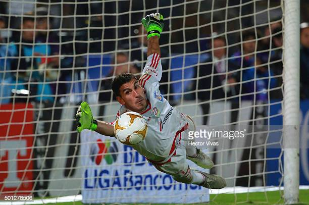 Nahuel Guzman of Tigres saves the penalty kick during the final second leg match between Pumas UNAM and Tigres UANL as part of the Apertura 2015 Liga...
