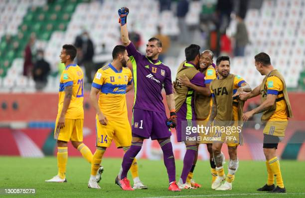 Nahuel Guzman of Tigres UANL celebrates with teammates at full-time after the FIFA Club World Cup Qatar 2002 Semi-Final match between Palmeiras and...