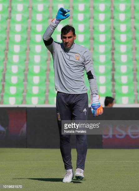 Referee Jorge Antonio Perez Duran gives directions to AndrePierre Gignac of Tigres during the fifth round match between Santos Laguna and Tigres UANL...