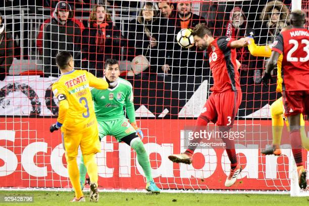 Nahuel Guzmán of Tigres UANL watches a header by Drew Moor of Toronto FC during the CONCACAF Champions League Quarterfinal match between Toronto FC...