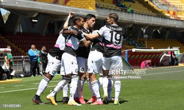 Nahuel Molina of Udinese Calcio celebrates with teammates after scoring their team's first goal during the Serie A match between Benevento Calcio and...