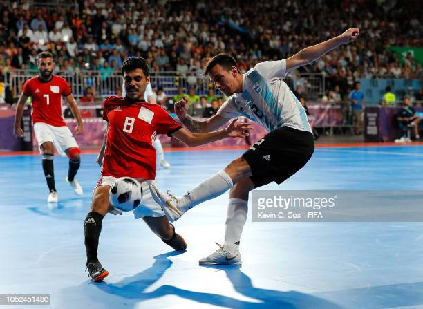 Nahuel Urriza of Argentina is challenged by Mohamed Ahmed of Egypt in the Men's Futsal 3rd Place match between Egypt and Argentina during the Buenos...