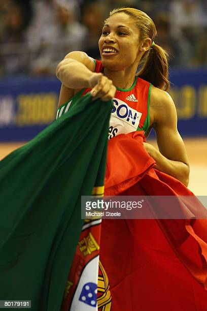 Naide Gomes of Portugal celebrates her Gold Medal win after the Womens Long Jump Final during the 12th IAAF World Indoor Championships at the Palau...