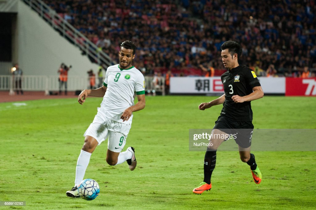Naif Hazazi (L) from Saudi Arabia in action against Theerathon Bunmathan (R) of Thailand during 2018 FIFA World Cup Qualifier Group B match between Thailand and Saudi Arabia at the Rajamangala National Stadium in Bangkok, Thailand, on March 23, 2017.