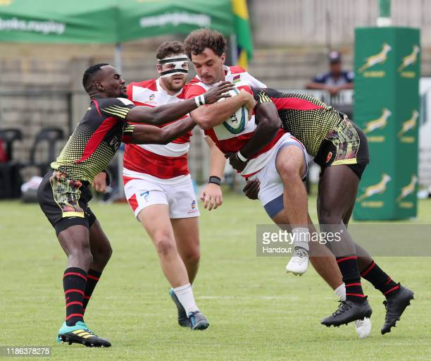 Naigrot Florian of Mauritius challenged by Ogena Pius of Uganda during the 2019 Rugby Africa Mens 7s match between Uganda and Mauritius at the Bosman...