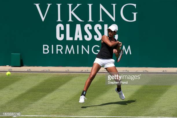 Naiktha Baines of Great Britain in action against Vitalia Diatchenko of Russia in qualifying warms up playing football during the Viking Classic...