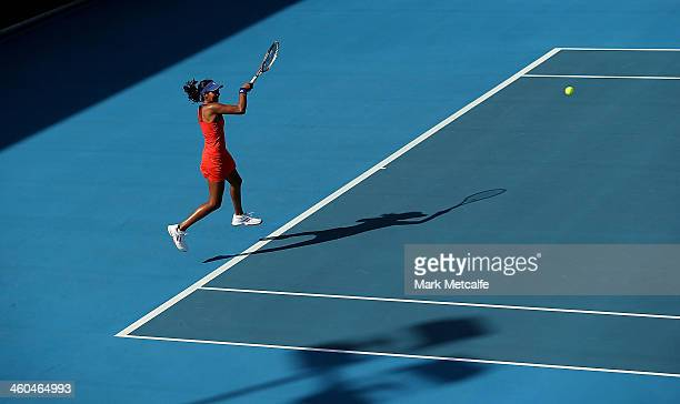 Naiktha Bains of Australia plays a forehand in her qualifying singles match against Teliana Pereira of Brazil during the Moorilla Hobart...