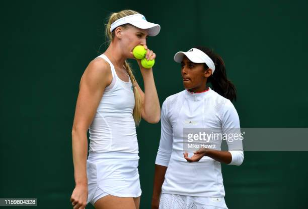 Naiktha Bains of Great Britain and Naomi Broady of Great Britain prepare a serve in their Ladies' Doubles first round match against Barbora...