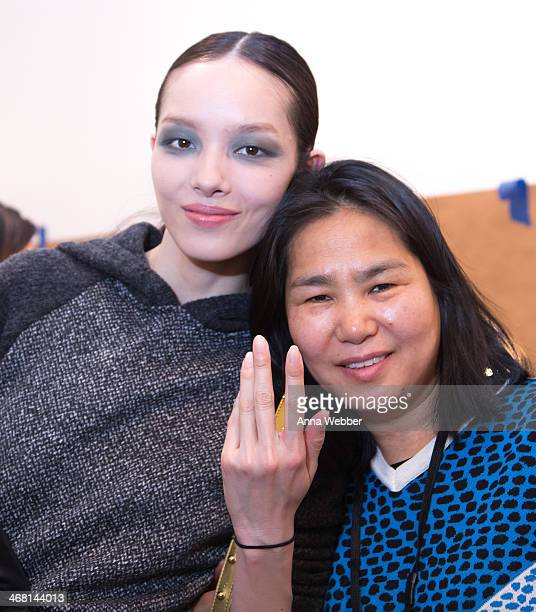 Nail Care designer Jin Soon Choi poses with a model backstage during JINsoon at Derek Lam Fall/Winter 2014 at Sean Kelly Gallery on February 9 2014...