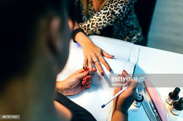 nail grooming in beauty salon - nail salon stock pictures, royalty-free photos & images