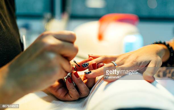 nail grooming in beauty salon - fingernail stock pictures, royalty-free photos & images