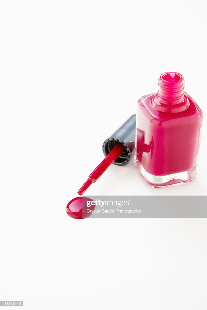 Nail Polish Bottle And Dripping Applicator Stock Photo | Getty Images