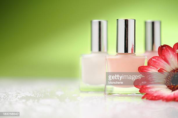 Nail polish bottles with a flower