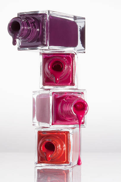 Nail polish dripping from a stack of bottles