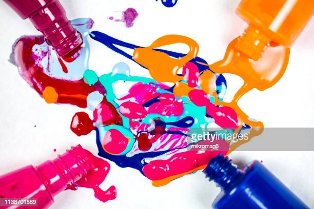 nail varnish spilling onto white background. abstract background - マニキュア液 ストックフォトと画像