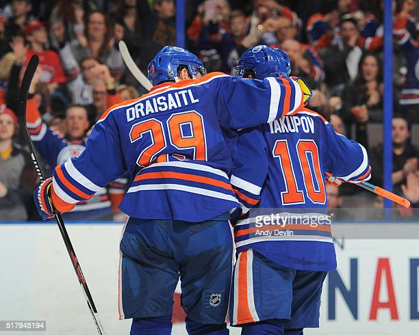 Nail Yakupov and Leon Draisaitl of the Edmonton Oilers celebrate after a goal during the game against the Anaheim Ducks on March 28 2016 at Rexall...