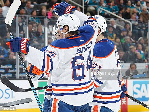 Nail Yakupov Andrew Ference and Jordan Eberle of the Edmonton Oilers celebrate after a goal against the San Jose Sharks during an NHL game on January...